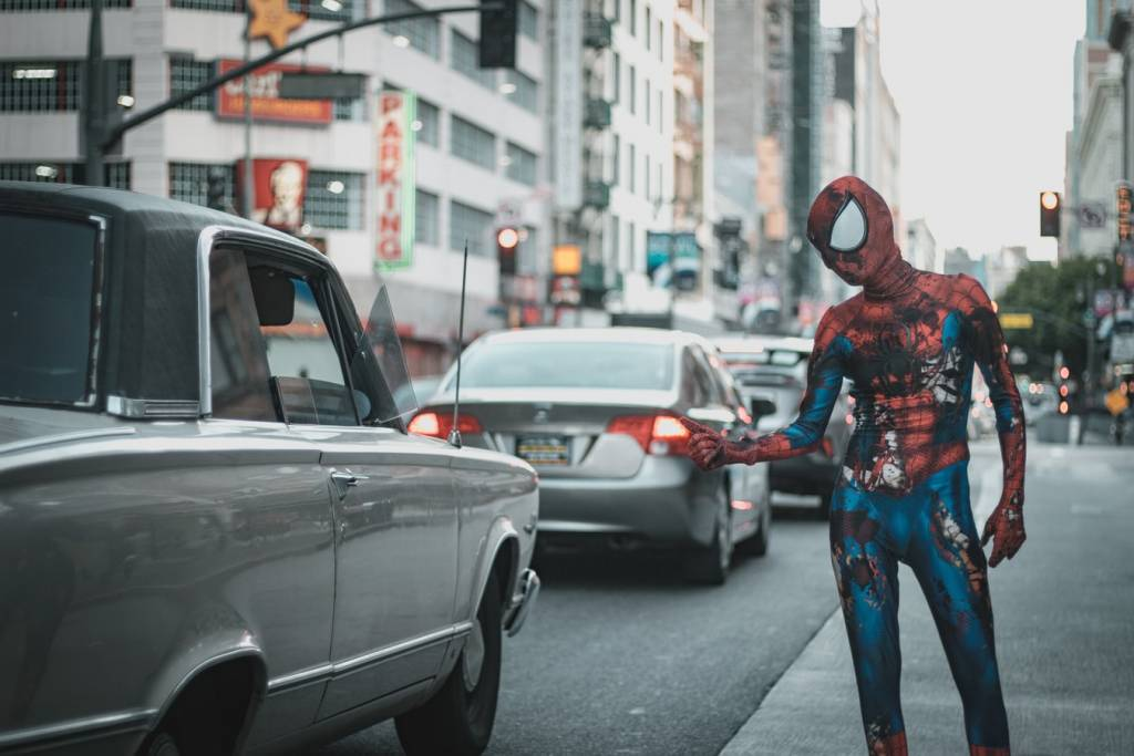 Ratty spiderman hitching a ride to a convention