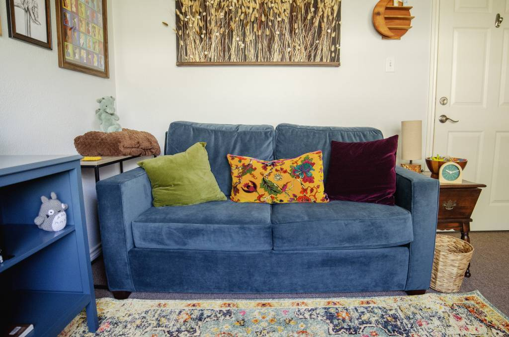 counseling office blue couch with pillows